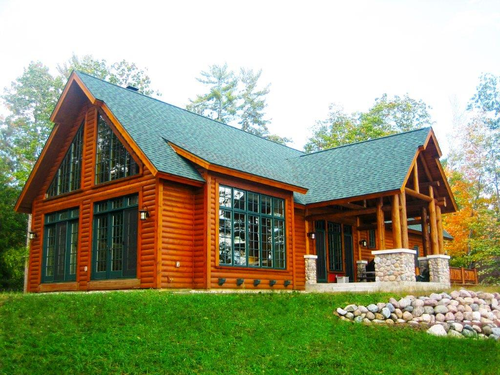 Modular home builder dickinson homes builds an for Log cabins homes