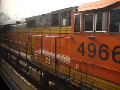 Bright orange BNSF engine with yellow stripes