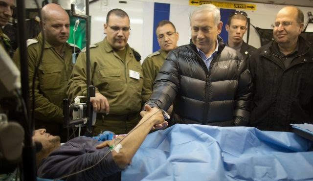 Israel's prime minister, Binyamin Netanyahu, meets with 'rebel' who was wounded while fighting in Syria against that regime.