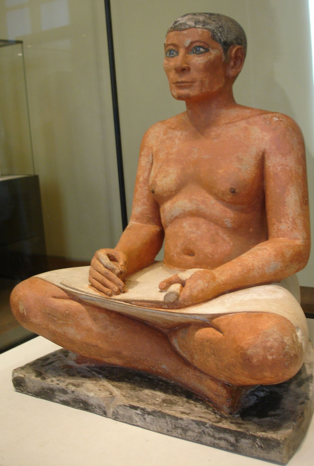 seated scribe Seated scribe or squatting scribe, limestone statue, with rock crystal, magnesite  and alloy of copper and arsenic used for the eyes, nipples in wood, cm 53,7.