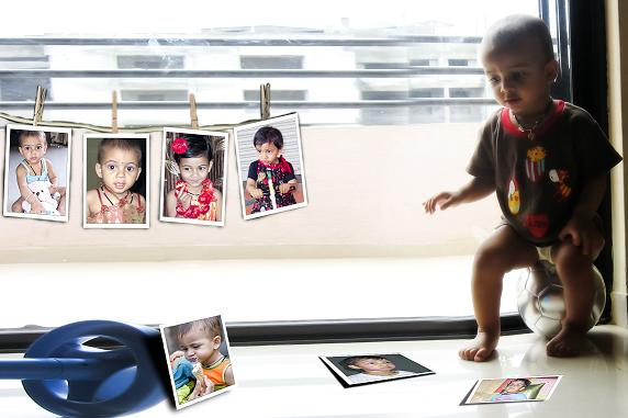 photo of baby girl sitted on football and whaching her photo