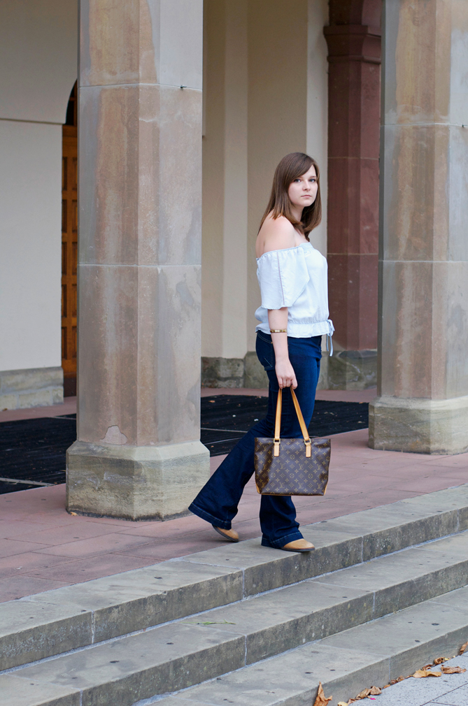 flared jeans off-the-shoulder