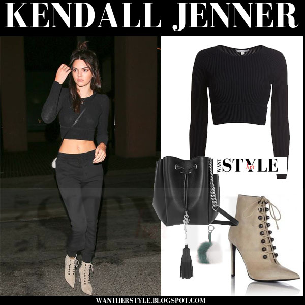 Kendall Jenner in black crop top, black pants, beige suede balenciaga ankle boots models off duty what she wore