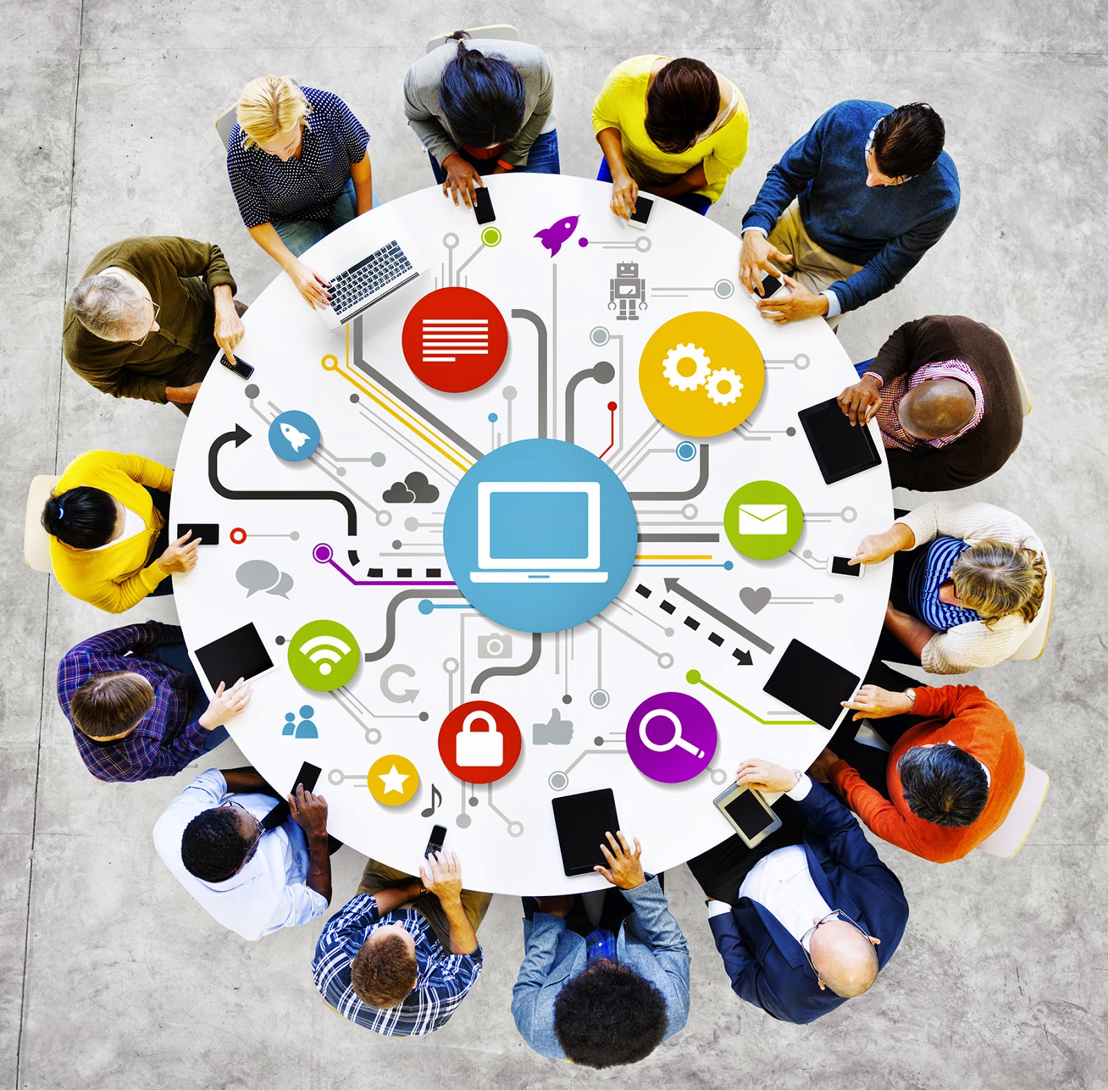 Image of a group of people sitting around the table with networking icons interconnecting them.
