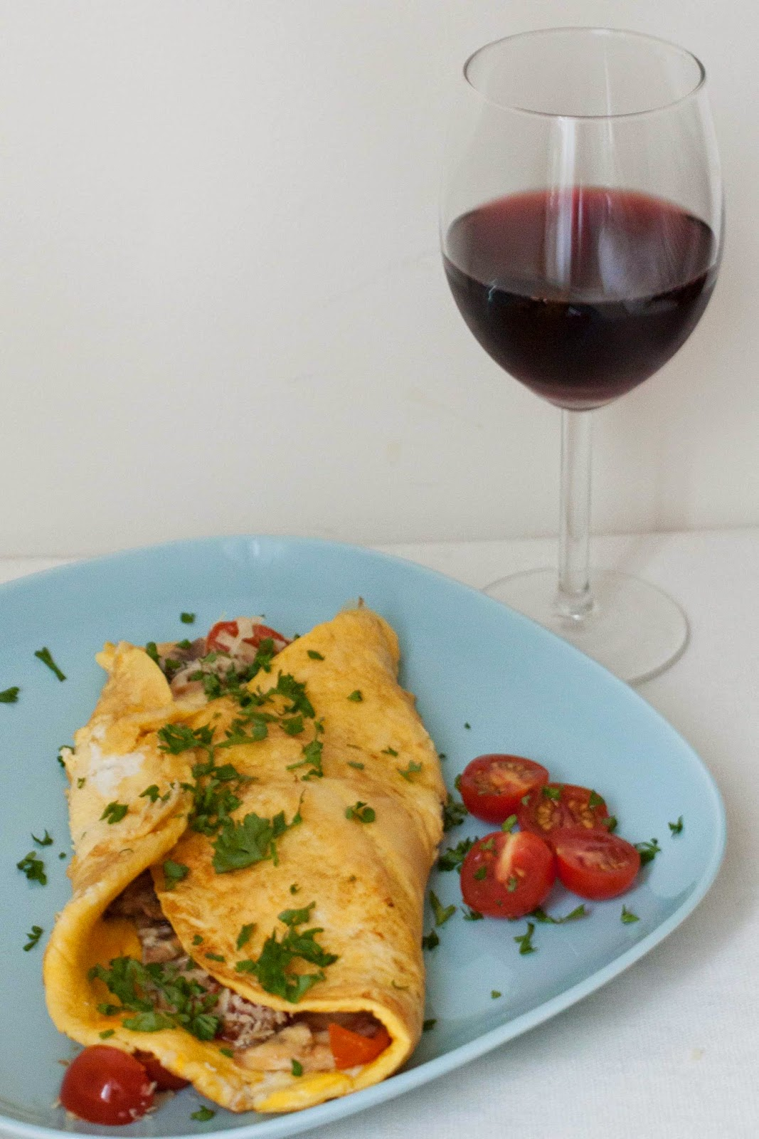 an omelette and a glass of wine essay