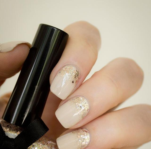 Nails Painted with Porcelain Colour and Golden Glitter.