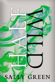 Cover of Half Wild, featuring swirls of green liquid that form the silhouette of a howling wolf's head against a grey background.