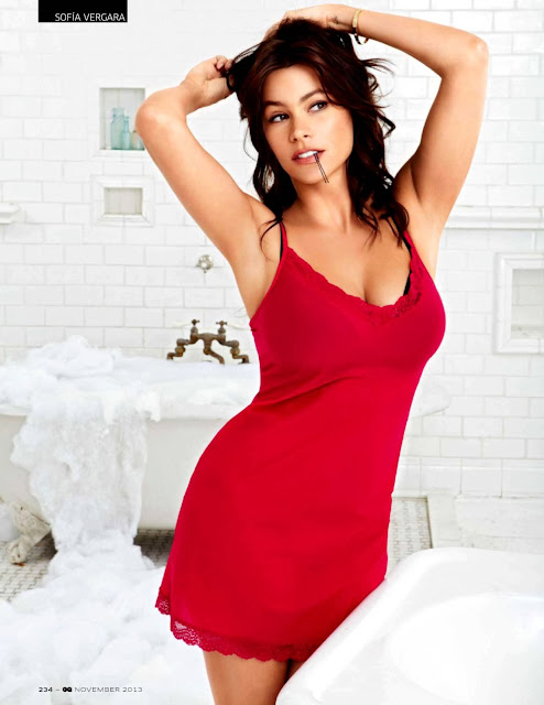 sofia vergera posing in red