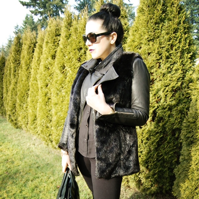 Black Simply Vera Wang faux fur vest, Mackage Kenya leather and a Celine Mini Luggage handbag.