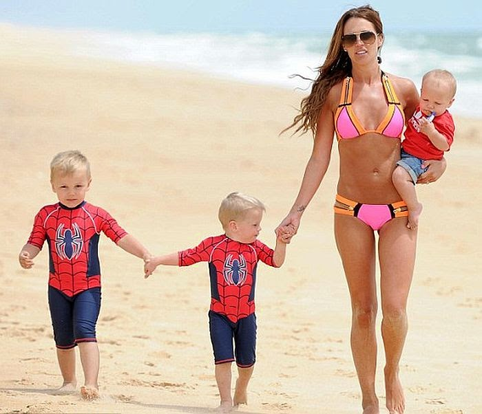 the 30-year-old, Danielle Lloyd impressed the judges with a pink bikini as she enjoyed a stroll with her three childs in Portugal on Tuesday, June 3, 2014.