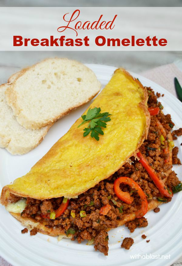 Beef, gooey cheese and more in this Loaded Breakfast Omelette and it's not only for breakfast !