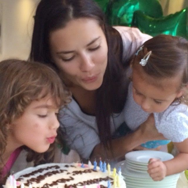 And she also shared her family wonderful moment during the bright day as she's blowing out the candles with her four year old daughter, Valentina and 21 month old daughter, Sienna.