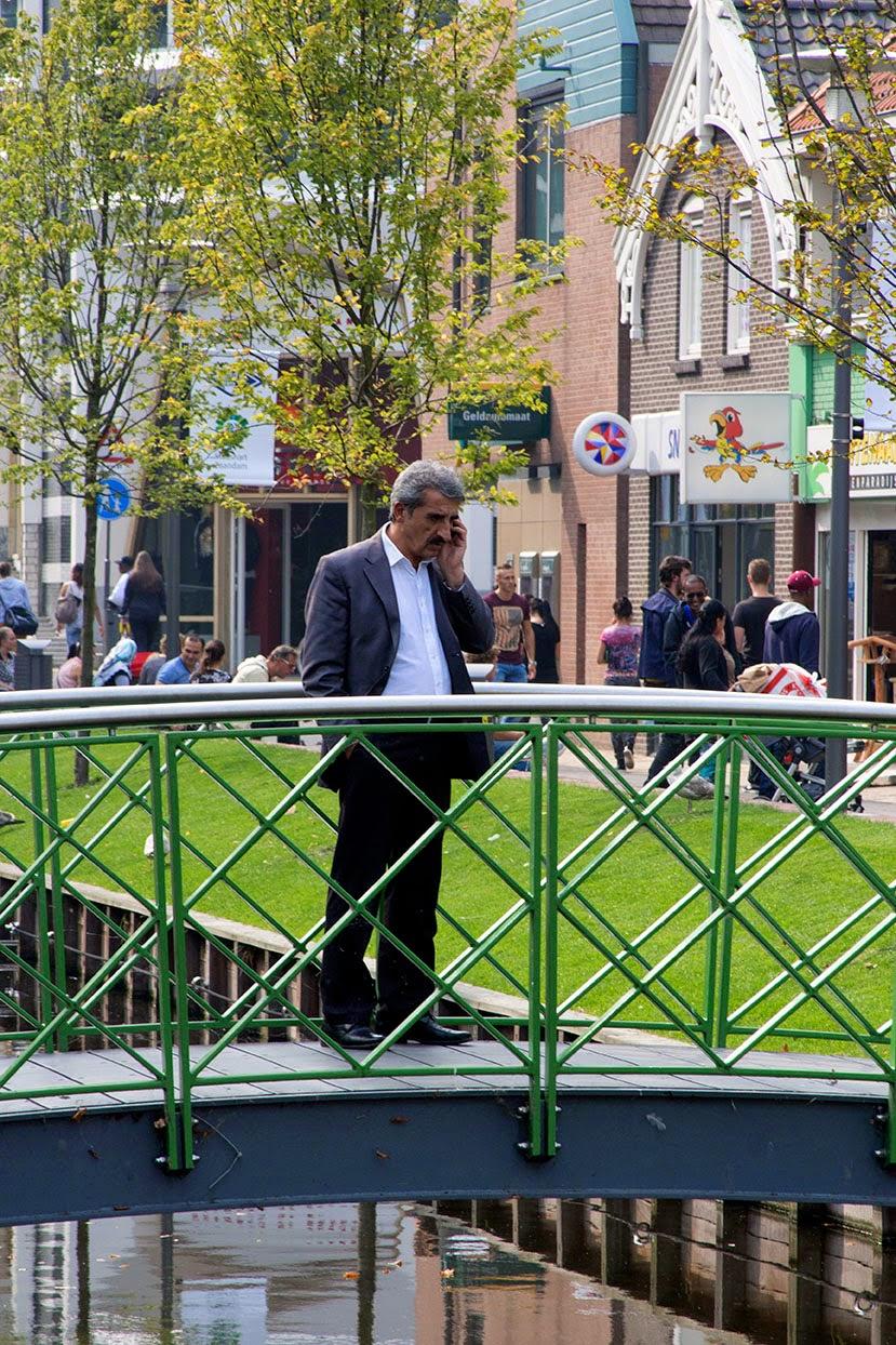 man on bridge in telephone conversation
