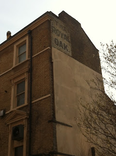 Ghost sign for The Royal Oak pub, now The Temperance, Enford Street, London W1