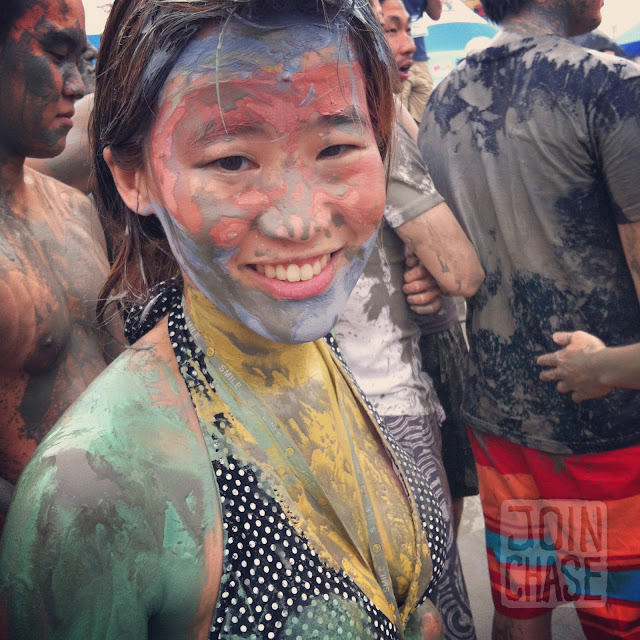 A woman painted with colorful mud at the Boryeong Mud Festival 2012 in South Korea.