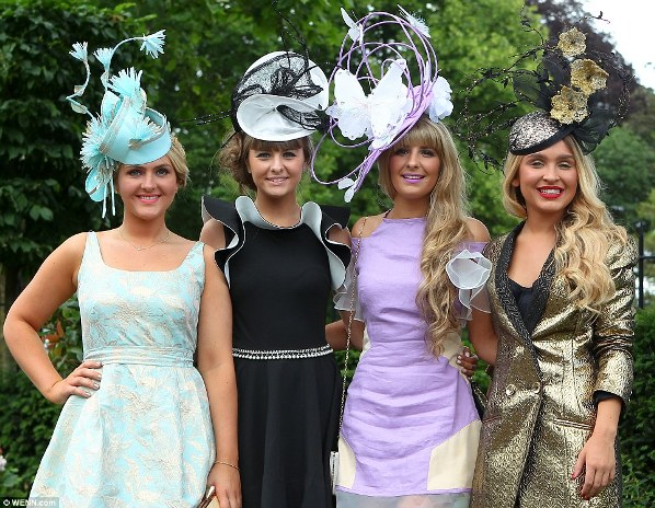 colorful and elegant young racegoers on day 2 at Royal Ascot 2014