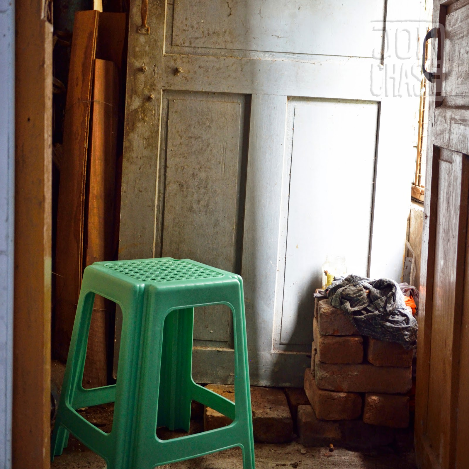 A plastic stool in a small sitting area in a kitchen of an apartment in Yangon, Myanmar.