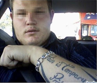 Failed tattoo - tough guy with a misspelled tattoo on the forearm