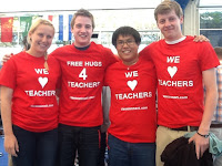 this is a picture of 4 students wearing shirts that say i love teachers