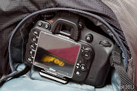 A Nikon D600 with a tripod plate attached barely fits through the Clik Elite Obscura side access panel.
