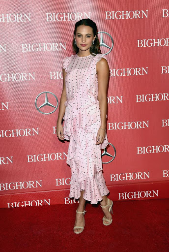 The Danish Girl actress Alicia Vikander in a polka-dot pink dress at the Palm Springs International Film Festival red carpet dresses