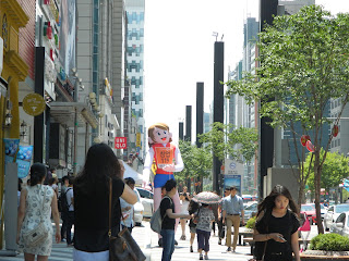 Skyscraper in Gangnam area with a huge doll in Seoul