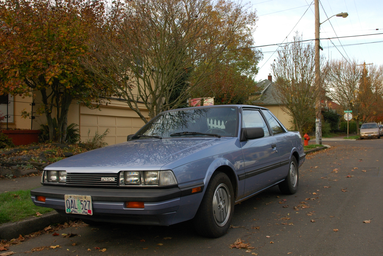 OLD PARKED CARS.: 1985 Mazda 626 Coupe.