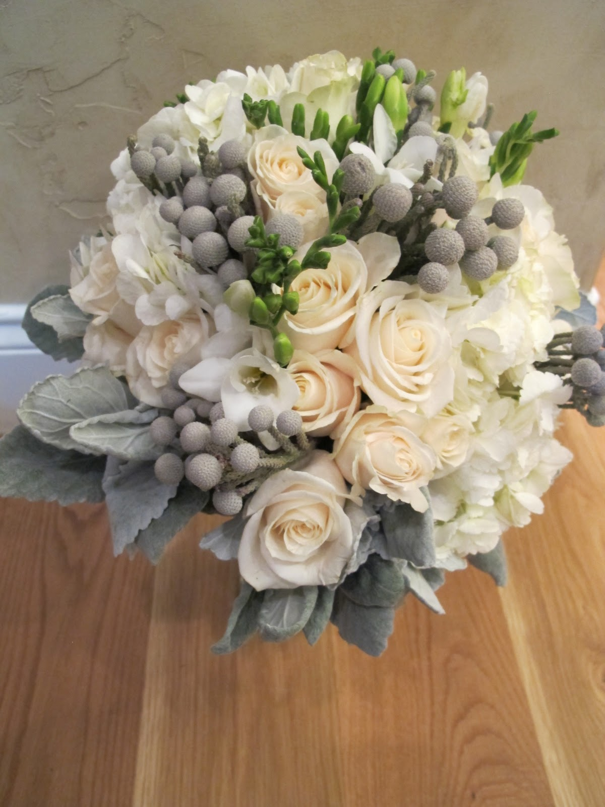 Hydrangea Cream Roses Silver Brunia And Freesia With Dusty Miller
