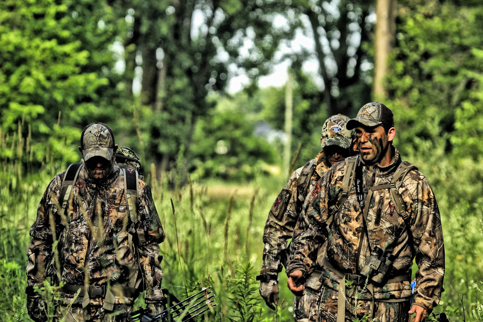 trio of hunters in camo
