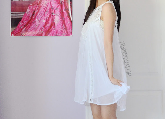 Prepare for summer with this cute lacy white crochet-neckline babydoll shift dress from SheIn!