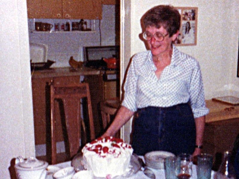 Marion Shuman with cake - May 1983 - in Israel