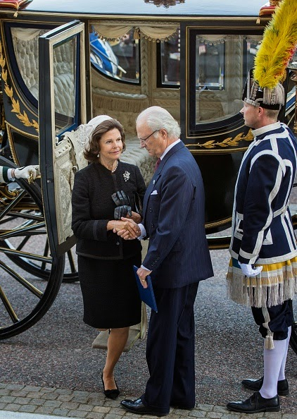 Sweden's King Carl Gustaf and Queen Silvia arrive to attend the opening of the Swedish parliament in Stockholm