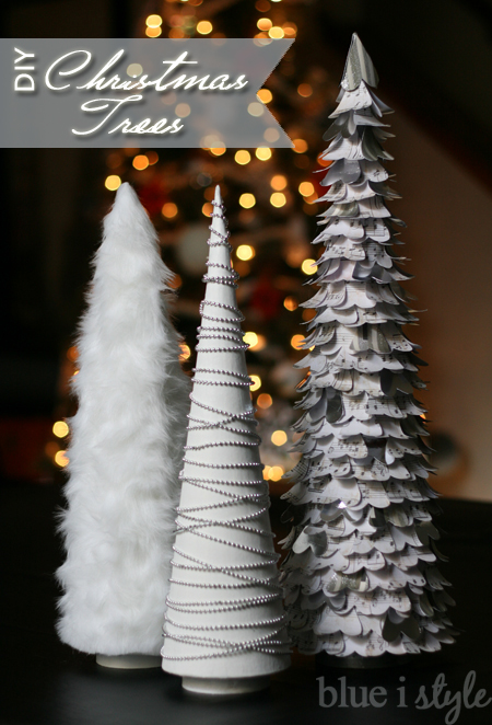 mini christmas mache trees, covered in fake fur, paper hearts and bead garlands