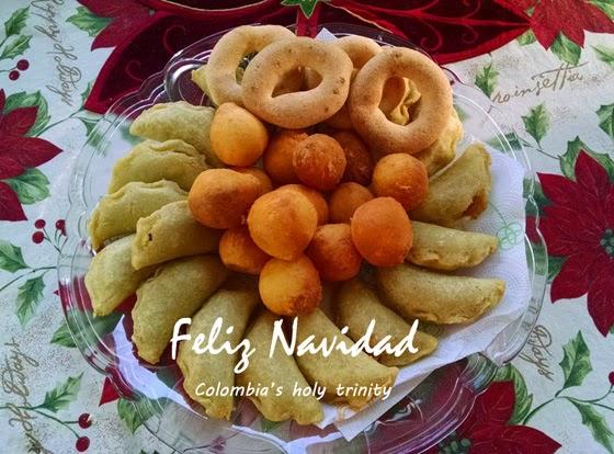 A plate with holiday latin foods - empanadas, bunuelos, pandequesos