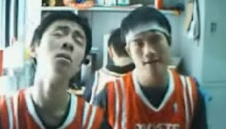 Two Chinese boys lip syncing to Backstreet Boys' classic hit, I Want It That Way.