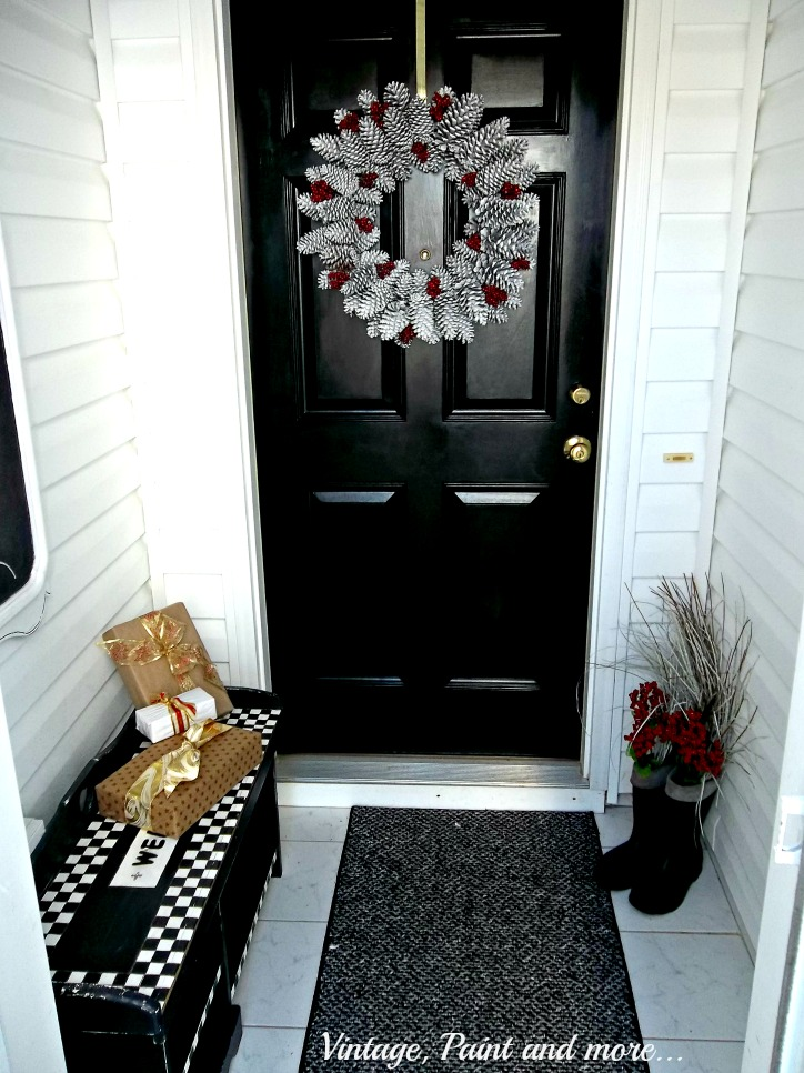 Vintage, Paint and more... Christmas entryway with pine cone wreath and packages from cereal boxes and brown parcel paper