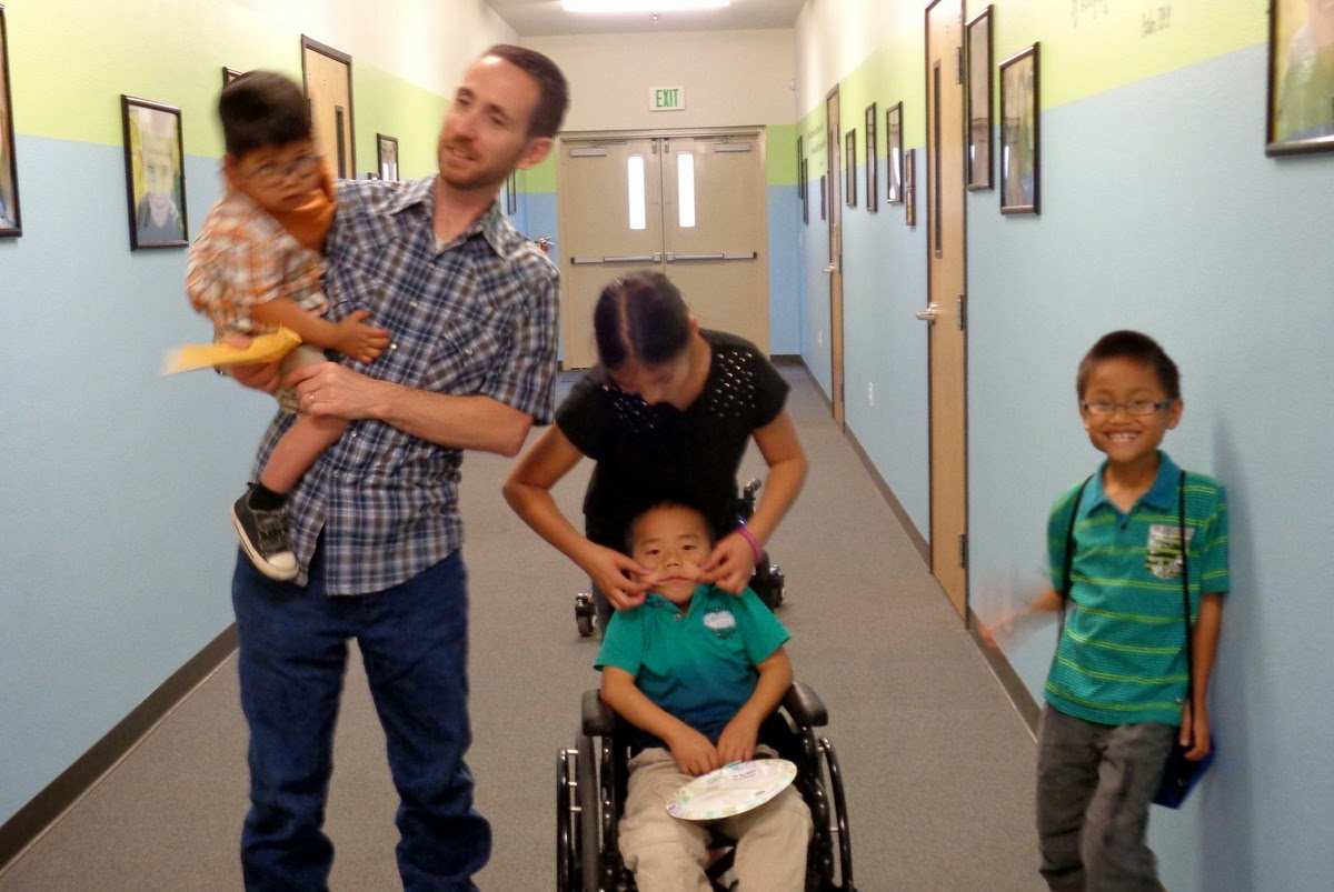 Kevin with Daniel, Katie, Michael and Eli outside the church nursery