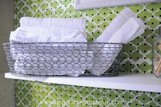 Terry Towels rolled up in a bread basket | OrganizingMadeFun.com
