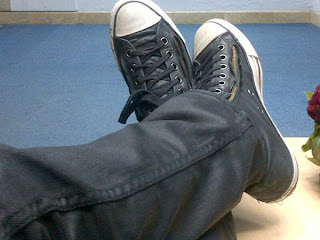 Greyson Chance trademark black leather zip converse