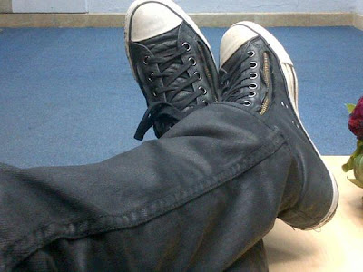 Greyson Chance's trademark black leather converse