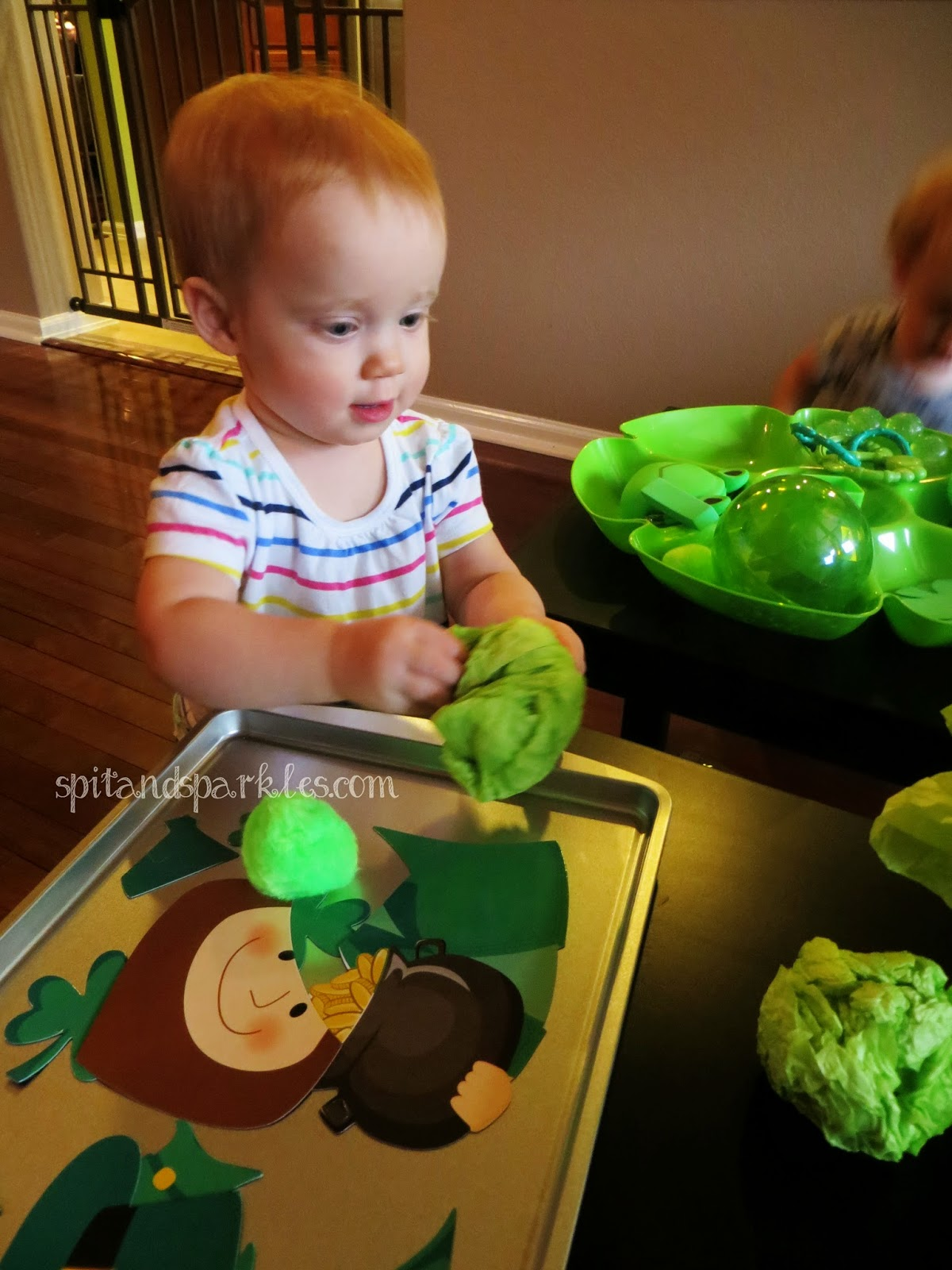 Grab a metal cookie sheet from the dollar store along with a set of magnets and let baby learn to arrange them in order for a fine & gross motor skills activity. #totschool #homeschool #earlylearning #StPatricksDay
