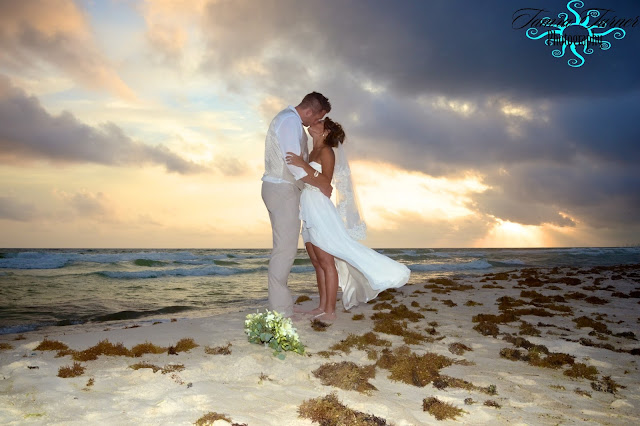 beach wedding photo at sunset over St. Andrew's State Park