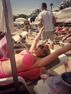Relaxing on a sunlounger on C Beach, Cannes