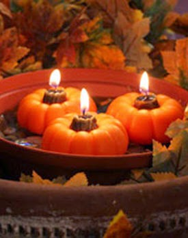 Floating pumpkin candles for your Thanksgiving table centerpiece.