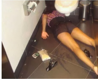 funny picture: drunk girl fell beside the toilet