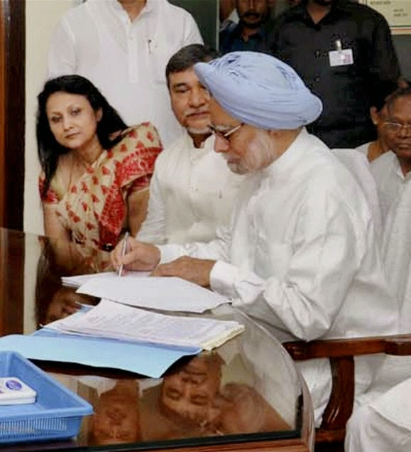 Prime Minister Manmohan Singh files his nomination papers for Rajya Sabha elections, in Guwahati on May 15. Photo:PTI