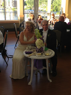 Debbie and Gene at their wedding reception at the Oconomowoc Community Center overlooking Lac La Belle