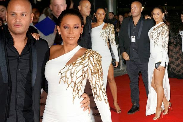 It's simple but beautiful as Melanie Brown looked so chic and polished while attending the MOBO awards as co-hosted in London, England on Wednesday, October 22, 2014. Wearing the dress design by Julien McDonald, the 39-year-old kept things on the more sophisticated side with an elegant flowing white floor-length gown.