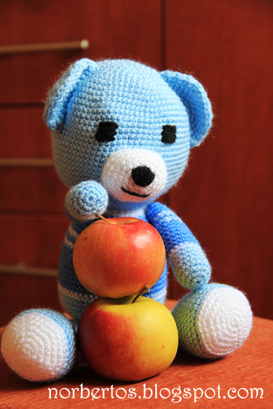 Crochet blue bear with apples