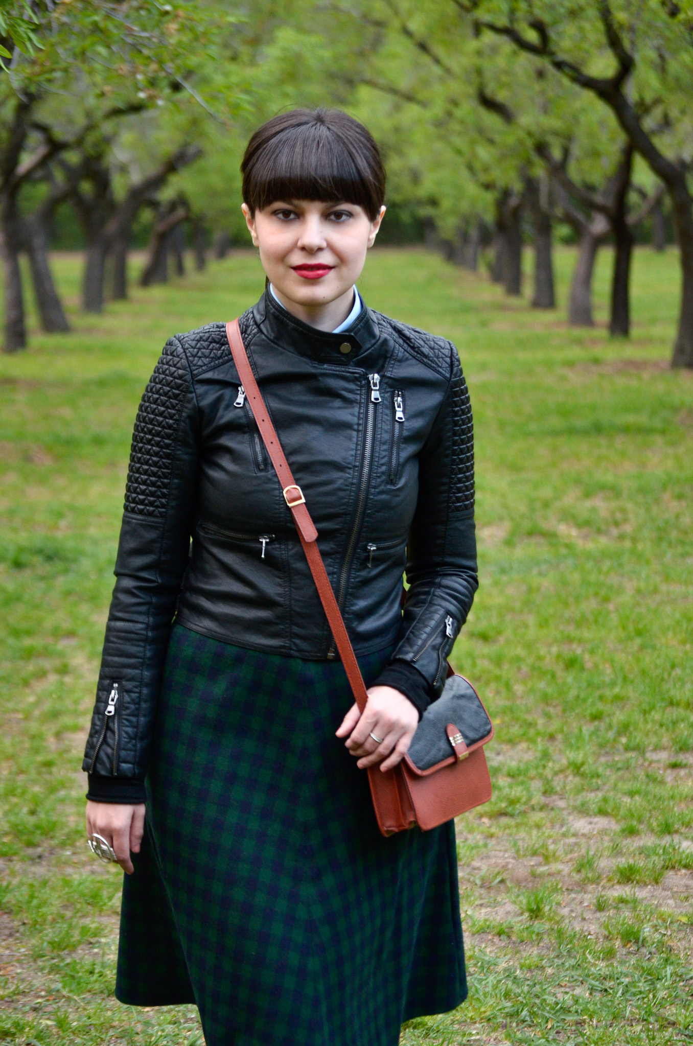 school girl outfit in madrid green tartan midi skirt thrifted brown bag satchel sky blue shirt black bow tie bangs burgundy oxford shoes poema spring green fresh park